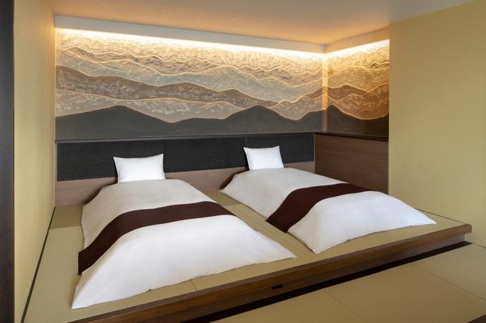 星野リゾート 界 霧島「シラス壁のベッドボード」